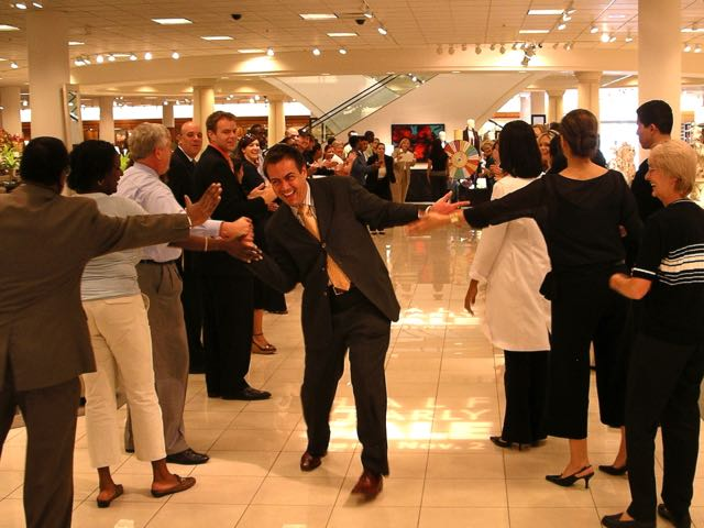 Associates line up on both sides to congratulate outstanding sales associates at Nordstrom. Photo by J. Jeff Kober.